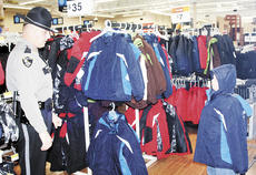 """<div class=""""source"""">Bryan Marshall, staff writer</div><div class=""""image-desc"""">Officer Ron Perkins of the Williamstown Police Department helps his young man choose a coat at Wal-Mart. The program operates on funds from a golf scramble and donations, as well as discounts at local businesses.</div><div class=""""buy-pic""""><a href=""""http://web2.lcni5.com/cgi-bin/c2newbuyphoto.cgi?pub=195&orig=coat.jpg"""" target=""""_new"""">Buy this photo</a></div>"""