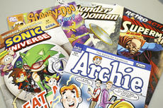 "<div class=""source"">Linda Lawrence</div><div class=""image-desc"">Sports Card and Gaming Exchange stock a variety of comics.</div><div class=""buy-pic""><a href=""/photo_select/12107"">Buy this photo</a></div>"
