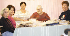 "<div class=""source"">Linda Lawrence</div><div class=""image-desc"">Left to right, Martha Hicks, Sue Planks, who is not a CBC member, Rosalie Tunks, who began the project, Jerry Breedingburg and Ann Greene package homemade cookies to send to troops overseas. </div><div class=""buy-pic""></div>"