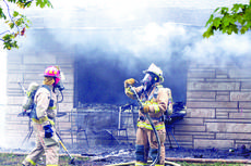 """<div class=""""source"""">Jamie Baker-Nantz</div><div class=""""image-desc"""">Firefighters work to put out a fire at 275 Cottonwood Drive in Dry Ridge on Sept. 29. The fire began in the living room and quickly spread to the remainder of the brick structure. The cause of the fire has not yet been determined. The home was rented by J</div><div class=""""buy-pic""""><a href=""""/photo_select/1831"""">Buy this photo</a></div>"""