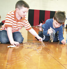 """<div class=""""source"""">Jamie Baker-Nantz</div><div class=""""image-desc"""">Dry Ridge Elementary students Dylan Gibson, left, and Samuel Deatherage, right, count out 100 pennies. </div><div class=""""buy-pic""""><a href=""""/photo_select/13356"""">Buy this photo</a></div>"""