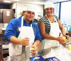"""<div class=""""source""""></div><div class=""""image-desc"""">        Senior Lauren Haney and Jordan Kinman grate cheese as they prepare a meal for 300 plus individuals for a Lexington Farmer's Market dinner.  </div><div class=""""buy-pic""""><a href=""""/photo_select/19225"""">Buy this photo</a></div>"""