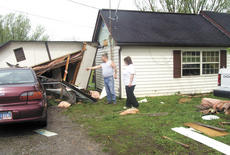 """<div class=""""source"""">Jamie Baker-Nantz</div><div class=""""image-desc"""">John Cuneo points to where his garage used to stand before it was smashed by a tornado on April 24. Cuneo and his wife, Carol, live on Folsom-Jonesville Road. He said they'd spent a lot of time, effort and money fixing up the home that was severely damaged. </div><div class=""""buy-pic""""></div>"""