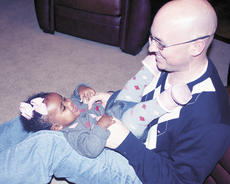 "<div class=""source"">Bryan Marshall, staff writer</div><div class=""image-desc"">Doug Stanley spends time bonding with Lola Joy.</div><div class=""buy-pic""><a href=""/photo_select/2797"">Buy this photo</a></div>"
