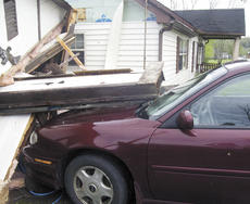 """<div class=""""source"""">Jamie Baker-Nantz</div><div class=""""image-desc"""">At the Cuneo's, the strong winds, ranging from 86 to 110 miles per hour, blew out the side of the garage and toppled the garage door onto Cuneo's car.</div><div class=""""buy-pic""""></div>"""