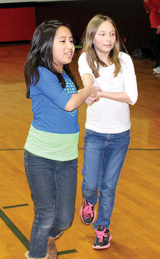 """<div class=""""source""""></div><div class=""""image-desc"""">DRE students Yareth Aguazul and Caylee Lacey dance together during gym class. Photo by Jamie Baker-Nantz</div><div class=""""buy-pic""""><a href=""""/photo_select/21067"""">Buy this photo</a></div>"""