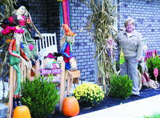 """<div class=""""source"""">Jamie Baker-Nantz</div><div class=""""image-desc"""">Debbie Glass enjoys decorating so much that this year she decorated her daughter's Dry Ridge home for fall.</div><div class=""""buy-pic""""><a href=""""/photo_select/1466"""">Buy this photo</a></div>"""