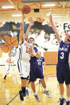 """<div class=""""source""""></div><div class=""""image-desc"""">Zach Rose keeps the ball away from two Walton-Verona Bearcat players. Despite hard play, the Demons lost to W-V 61 - 40. Photos by Hailey Jacobs</div><div class=""""buy-pic""""><a href=""""/photo_select/16723"""">Buy this photo</a></div>"""