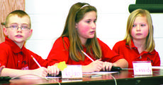 "<div class=""source""></div><div class=""image-desc"">Nolan Calhoun, Cassidy Lacey and Allie Schawe, members of the Dry Ridge Elementary quick recall team, ponder a question during the District Governor's Cup held at Crittenden-Mount Zion Elementary.</div><div class=""buy-pic""><a href=""/photo_select/6080"">Buy this photo</a></div>"