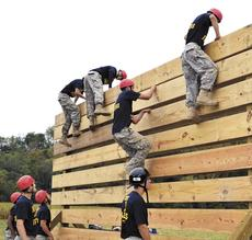 """<div class=""""source""""></div><div class=""""image-desc"""">Cadets Welle, Smith, Saylor, Haubner, Cummins, Branscom, Simpson, Crockette and Alex Smith scaling the 12 foot vertical wall on the Obstacle Course</div><div class=""""buy-pic""""><a href=""""/photo_select/19090"""">Buy this photo</a></div>"""