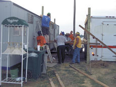 """<div class=""""source""""></div><div class=""""image-desc"""">Volunteers work to set up for the Grant County Fair and Horse Show, which will be July 29 through Aug. 6 at the Northern Kentucky Fairgrounds in Williamstown.</div><div class=""""buy-pic""""><a href=""""/photo_select/11554"""">Buy this photo</a></div>"""