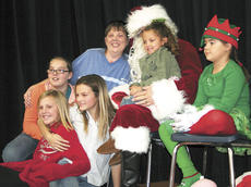 "<div class=""source""></div><div class=""image-desc"">Sue King, Elizabeth King, Haley Dixon, Corrtney Thompson and Myshayla Williams all pose with Santa at Santa's Wonderland. Photo by Jamie Baker-Nantz. </div><div class=""buy-pic""><a href=""http://web2.lcni5.com/cgi-bin/c2newbuyphoto.cgi?pub=195&orig=family_0.jpg"" target=""_new"">Buy this photo</a></div>"