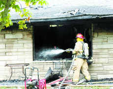 """<div class=""""source"""">Jamie Baker-Nantz</div><div class=""""image-desc"""">Firefighters from Dry Ridge, Crittenden and Williamstown battled a blaze at Cottonwood Drive in Dry Ridge on Sept. 29.</div><div class=""""buy-pic""""><a href=""""/photo_select/1833"""">Buy this photo</a></div>"""