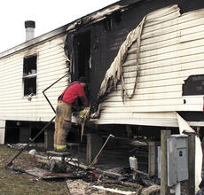 "<div class=""source"">Jamie Baker-Nantz</div><div class=""image-desc"">Capt. Greg Hearn of the Dry Ridge Fire Department peers inside a mobile home that was destroyed in a blaze on Feb. 11. </div><div class=""buy-pic""></div>"