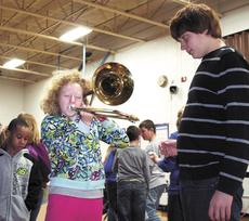 "<div class=""source""></div><div class=""image-desc"">Sierra Luke blows as hard as she can in to the trombone while Billy Engelman oversees her progress. </div><div class=""buy-pic""><a href=""/photo_select/17894"">Buy this photo</a></div>"