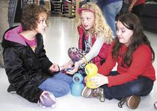 """<div class=""""source""""></div><div class=""""image-desc"""">These three young ladies didn't care how busy or crowded Wal-Mart in Dry Ridge was on a Saturday in December. They plopped down and took time to play with toys they selected in the Shop With A Cop program. Photo by Jamie Baker-Nantz</div><div class=""""buy-pic""""><a href=""""http://web2.lcni5.com/cgi-bin/c2newbuyphoto.cgi?pub=195&orig=girls%2Bin%2Bfloor.jpg"""" target=""""_new"""">Buy this photo</a></div>"""