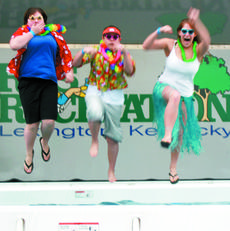"""<div class=""""source"""">Bryan Marshall, staff writer</div><div class=""""image-desc"""">Williamstown students Kate Metcalf and Cody Deaton, both sophomores, and Tiffany Foley, a freshman, dive in during the Polar Bear Plunge in Lexington.</div><div class=""""buy-pic""""><a href=""""/photo_select/8201"""">Buy this photo</a></div>"""