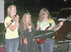 """<div class=""""source""""></div><div class=""""image-desc"""">Claire Kinmon, Sarah Roberts and Ciarra Krist, students at Williamstown High School sang during the 2010 See You At The Pole event on Sept. 22.</div><div class=""""buy-pic""""><a href=""""/photo_select/3995"""">Buy this photo</a></div>"""