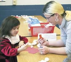 """<div class=""""source""""></div><div class=""""image-desc"""">Dry Ridge Elementary preschooler Kiara Fenno glues a craft together with her mother, Rachael Fenno during Pancakes With Parents. </div><div class=""""buy-pic""""><a href=""""/photo_select/16573"""">Buy this photo</a></div>"""