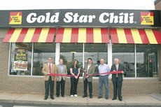 """<div class=""""source""""></div><div class=""""image-desc"""">From left to right, Mike Mason, VP Operations Gold Star Chili, Charlie Howard, VP Marketing Gold Star Chili, Cindy and Rami Nwaisser, Owners Gold Star Chili – Crittenden, Jim Purcell, Vice Mayor City of Crittenden, Mike Rohrkemper, CEO Gold Star Chili.</div><div class=""""buy-pic""""></div>"""
