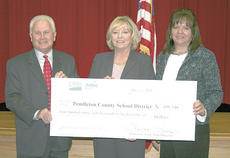 "<div class=""source"">Bryan Marshall</div><div class=""image-desc"">Williamstown Independent Superintendent Sally Skinner, middle, and Tammy Steele, district chief information officer, pose with a ceremonial check from Tom Fern, state director for rural development. The nearly $500,000 grant is in collaboration with Pendleton and Gallatin County schools. Photo by Bryan Marshall</div><div class=""buy-pic""><a href=""/photo_select/12880"">Buy this photo</a></div>"