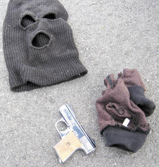 "<div class=""source""></div><div class=""image-desc"">Police recovered these items near Corinth Lake after a robbery on March 7.</div><div class=""buy-pic""></div>"