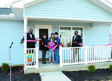"<div class=""source""></div><div class=""image-desc"">Kim Nagle and her three grandchildren, Genevieve, Christopher and Sierrah, celebrate a ribbon cutting and dedication at their new Habitat home. Photos by Jerry Morris</div><div class=""buy-pic""><a href=""http://web2.lcni5.com/cgi-bin/c2newbuyphoto.cgi?pub=195&orig=house.jpg"" target=""_new"">Buy this photo</a></div>"