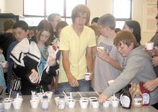 """<div class=""""source"""">Bryan Marshall, staff writer</div><div class=""""image-desc"""">Ashley Cook, Donovan Huff and other students gather toppings for their ice cream.</div><div class=""""buy-pic""""><a href=""""http://web2.lcni5.com/cgi-bin/c2newbuyphoto.cgi?pub=195&orig=icecream.jpg"""" target=""""_new"""">Buy this photo</a></div>"""