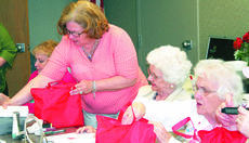 """<div class=""""source""""></div><div class=""""image-desc"""">Karen Collins, a volunteer for the American Cancer Society, and an employee at St. Elizabeth Medical Center Grant County, helps the ladies sort through their goody bags.</div><div class=""""buy-pic""""><a href=""""/photo_select/7212"""">Buy this photo</a></div>"""