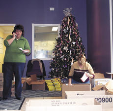 "<div class=""source""></div><div class=""image-desc"">Kim McKinnon and Tonya Sunyama of Family Worship Center pack boxes of food from Angel Food Ministries for distribution. The food is available monthly for $30 and anyone can order.</div><div class=""buy-pic""><a href=""/photo_select/1246"">Buy this photo</a></div>"