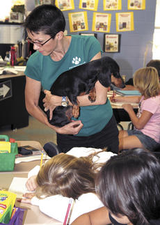 """<div class=""""source""""></div><div class=""""image-desc"""">Leigh Anne of Florence, owner of Woody, answers a question about one of her books she wrote and the many adventures they contain at Sherman Elementary School. </div><div class=""""buy-pic""""><a href=""""/photo_select/15967"""">Buy this photo</a></div>"""
