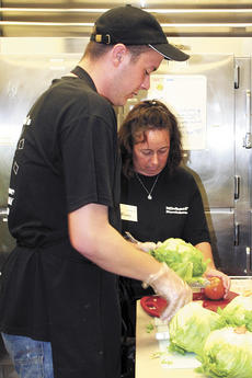 """<div class=""""source"""">Jamie Baker-Nantz</div><div class=""""image-desc"""">Employees at Michael's Steakhouse prepare a fresh salad. Michael's opened April 6 in Williamstown.</div><div class=""""buy-pic""""><a href=""""/photo_select/10133"""">Buy this photo</a></div>"""