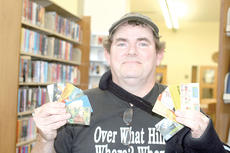 "<div class=""source""></div><div class=""image-desc"">Tim Maloney's passion is collecting library cards. He has collected them from states as far away as Washington and Wisconsin.</div><div class=""buy-pic""><a href=""http://web2.lcni5.com/cgi-bin/c2newbuyphoto.cgi?pub=195&orig=librarycardcollector.jpg"" target=""_new"">Buy this photo</a></div>"