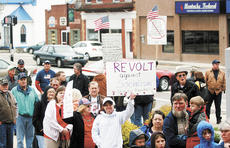 """<div class=""""source""""></div><div class=""""image-desc"""">Protesters line up to sign a petition during the Tax Day Tea Party at the Grant County Courthouse.</div><div class=""""buy-pic""""><a href=""""/photo_select/5725"""">Buy this photo</a></div>"""