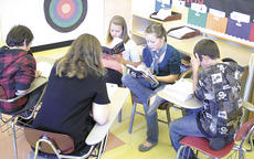 """<div class=""""source"""">Bryan Marshall</div><div class=""""image-desc"""">Students in Tina Withorn's Williamstown Jr. High class reads """"The Hunger Games"""" in a literacy circle. The district is hoping community members will read the popular book along with students through Dec. 21.</div><div class=""""buy-pic""""><a href=""""http://web2.lcni5.com/cgi-bin/c2newbuyphoto.cgi?pub=195&orig=literacycircle.jpg"""" target=""""_new"""">Buy this photo</a></div>"""