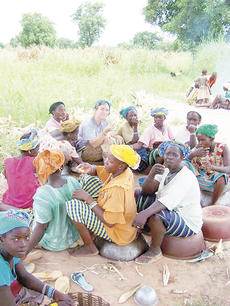 """<div class=""""source""""></div><div class=""""image-desc"""">Krystal Hutchinson of Dry Ridge eats lunch with villagers.</div><div class=""""buy-pic""""><a href=""""/photo_select/5748"""">Buy this photo</a></div>"""