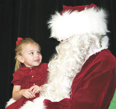 """<div class=""""source""""></div><div class=""""image-desc"""">Maliea Owens, 3, had no problem looking Santa in the eye and telling him exactly what she wanted for Christmas at the annual Williamstown Kiwanis Breakfast with Santa on Dec. 1. Watch upcoming issues for more photos from holiday happenings. Photo by Jamie Baker-Nantz</div><div class=""""buy-pic""""><a href=""""http://web2.lcni5.com/cgi-bin/c2newbuyphoto.cgi?pub=195&orig=maliea%2Bowens.jpg"""" target=""""_new"""">Buy this photo</a></div>"""