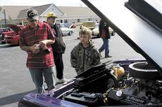 "<div class=""source""></div><div class=""image-desc"">Brayden Kenner, 3 of Cincinnati, and Hans Schreyere, also known as PopPop, check out a train car in the Derby Day Car Show, which had 81 vehicles. </div><div class=""buy-pic""><a href=""/photo_select/20596"">Buy this photo</a></div>"