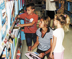"<div class=""source"">Bryan Marshall, staff writer</div><div class=""image-desc"">Angela Hedenberg of Crittenden helps her 7-year-old son Porter and 5-year-old daughter Macy pick out school supplies at the Dry Ridge Wal-Mart. </div><div class=""buy-pic""><a href=""http://web2.lcni5.com/cgi-bin/c2newbuyphoto.cgi?pub=195&orig=momandkids.jpg"" target=""_new"">Buy this photo</a></div>"
