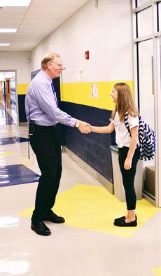 "<div class=""source"">Mark Verbeck, Photographer</div><div class=""image-desc"">       Grant County Middle School Principal John Preston shakes the hand of  Madison Mocahbee, the first  student to walk through the Grant County Middle School doors on the first day of school.     Photos by Bryan Marshall, Jamie Baker-Nantz,  Camille  McClanahan and Mark Verbeck </div><div class=""buy-pic""><a href=""http://web2.lcni5.com/cgi-bin/c2newbuyphoto.cgi?pub=195&orig=mr._preston_welcomes_madison_mocahbee_to_her_first_day_of_school1.jpg"" target=""_new"">Buy this photo</a></div>"