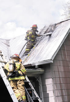 "<div class=""source"">Jamie Baker-Nantz</div><div class=""image-desc"">Brian Maines of the Williamstown Fire Department and Jacob Fox of the Corinth Fire Department, attempt to vent the roof at a fire on Old Depot Lane on April 18.</div><div class=""buy-pic""></div>"