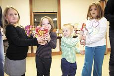 """<div class=""""source"""">Jamie Baker-Nantz</div><div class=""""image-desc"""">Karson Heaverin, Makayla Madden, Parker Heaverin and Lauren Cleveland work the assembly line to pack food boxes at Dry Ridge Baptist Church.</div><div class=""""buy-pic""""><a href=""""/photo_select/12740"""">Buy this photo</a></div>"""