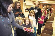 """<div class=""""source"""">Jamie Baker-Nantz</div><div class=""""image-desc"""">Tamela Smallwood starts the assembly line of food at the conclusion of the Dry Ridge Baptist Church Wall of Food drive. The annual food drive collected enough food to fill boxes for 53 families.</div><div class=""""buy-pic""""><a href=""""/photo_select/12738"""">Buy this photo</a></div>"""