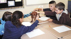 """<div class=""""source"""">Jamie Baker-Nantz </div><div class=""""image-desc"""">Sherman Elementary School students Bryar Webster and Jayden O'Neill have the chance to pet Woody. </div><div class=""""buy-pic""""><a href=""""/photo_select/15962"""">Buy this photo</a></div>"""