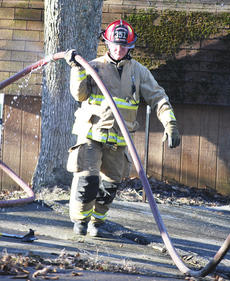 "<div class=""source"">Camille McClanahan</div><div class=""image-desc"">Kenny Ball, a Dry Ridge firefighter, drags hose around a log home on Cash Drive that was destroyed by a fire on Jan. 6.</div><div class=""buy-pic""></div>"