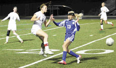 "<div class=""source""></div><div class=""image-desc"">GCHS Lady Brave Nicole Norman braces for a collision with a Lady Pioneer player in the team's 3-1 district championship defeat.</div><div class=""buy-pic""><a href=""/photo_select/15972"">Buy this photo</a></div>"