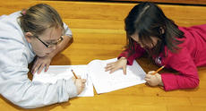"""<div class=""""source""""></div><div class=""""image-desc"""">Cassie Lewis, left, and her sister Mikayla Lewis, right, are in a race to see how many times they can write their name in 100 seconds on the 100th day of school at Mason-Corinth Elementary. Photo submitted.</div><div class=""""buy-pic""""></div>"""