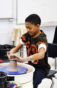 "<div class=""source""></div><div class=""image-desc"">Jalen Dixon takes the finished piece of pottery off the wheel.   </div><div class=""buy-pic""><a href=""/photo_select/17747"">Buy this photo</a></div>"