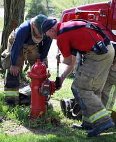 """<div class=""""source"""">Camille McClanahan</div><div class=""""image-desc"""">Firefighters from seven different fire departments battled a brush fire in Dry Ridge last week.</div><div class=""""buy-pic""""></div>"""
