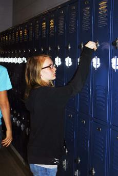 """<div class=""""source"""">Camille McClanahan</div><div class=""""image-desc"""">Grant County High School student Chensa Taylor stops by her locker between classes.</div><div class=""""buy-pic""""></div>"""